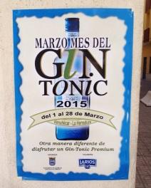 """Cartel pegado en una pared anunciando el """"Mes del Gin Tonic"""" en Almuñécar"""