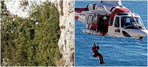 un-helicoptero-de-salvamento-maritimo-rescata-a-un-hombre-en-un-acantilado-de-la-punta-de-la-mona-en-la-herradura