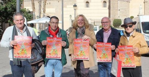 Flor Almón y Antonio Escámez (primero izqda) presentan el cartel de la Navidad Flamenca junto con miembros de la Peña Flamenca Ciudad de Motril